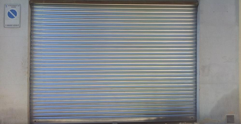 Instalaci n de cierres de comercio met licos ciegos - Cierres automaticos para puertas ...
